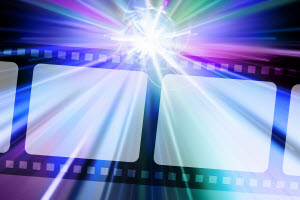 Filmstrip with light beams radiating from it